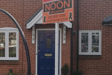 Noon Sold Board outside a house